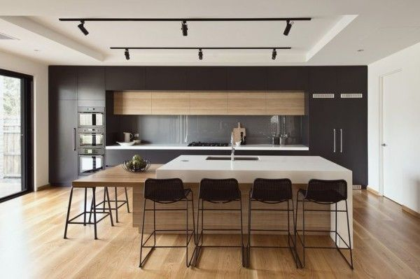Image of Modern Kitchen Island Lights Using Indoor Led Spotlight Bulbs on Track Ceiling Fixtures also Paddle Cutting Board Against Glass Backsplash Panels