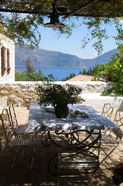 Kefalonia island, Greece...oh to have some fish, wine, cheese and olives sitting at that table with my family