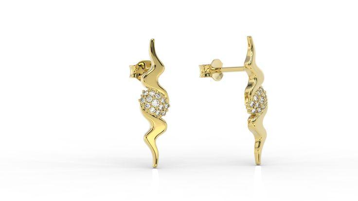 Geometryczne złote kolczyki z diamentami./  Geometric gold earrings with diamonds.