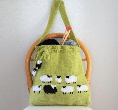 A stunning and unique bag featuring a flock of fluffy white sheep plus one black one.  The front, bottom and back of the bag are knitted in one piece. The side panels and shoulder strap are also knitted as one, and this makes for a strong bag to hold your knitting, shopping, beach items or anything else you can think of! The length off the strap can be adjusted if you prefer to use it as a handbag.  Bag size 40 cm wide x 46 cm tall (16 inches wide x 18 inches tall) excluding strap