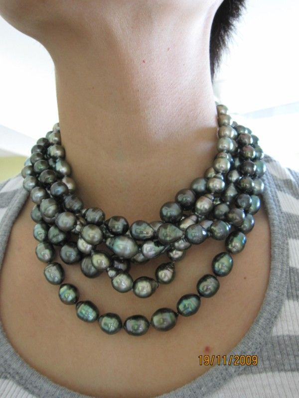 A luscious torsade of Tahitian pearls!  Cultivated in French Polynesia, these beauties are naturally dark.