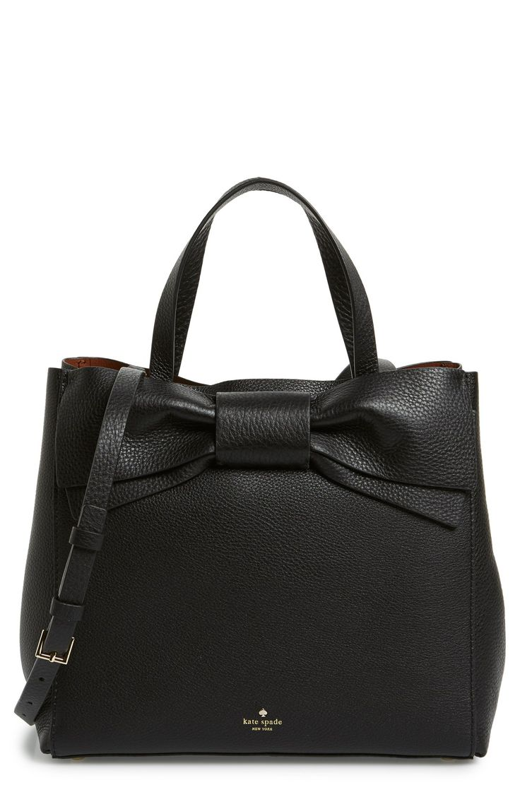 Crushing on this gorgeous leather Kate Spade handbag with an over-sized bow for an uptown chic look.