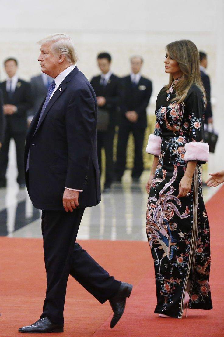 BEIJING, CHINA - NOVEMBER 9:  U.S. President Donald Trump and first lady Melania arrive for the state dinner at the Great Hall of the People on November 9, 2017 in Beijing, China. Trump is on a 10-day trip to Asia.  (Photo by Thomas Peter - Pool/Getty Images) via @AOL_Lifestyle Read more: https://www.aol.com/article/lifestyle/2017/11/09/melania-trump-wears-gucci-cheongsam-for-china-state-dinner/23272346/?a_dgi=aolshare_pinterest#fullscreen