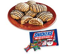 SNICKERS SURPRISE COOKIES   -   2 sticks butter (softened)  1 cup creamy peanut butter  1 cup light brown sugar  1 cup sugar  2 eggs  1 teaspoon vanilla  3 1/2 cups all purpose flour (sifted)  1 teaspoon baking soda  1/2 teaspoon salt  1 bag SNICKERS� Miniatures  1 bag DOVE� Milk or Dark Chocolate Gifts