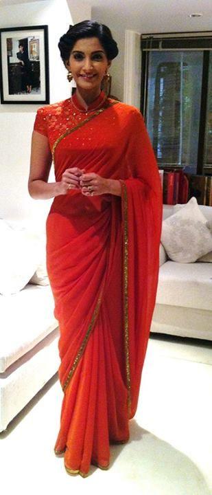 Sonam Kapoor in Tarun Tahiliani. Love the chikankari on the flame orange choli with high neck.