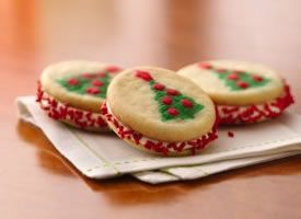 Super easy Christmas tree sandwich cookies.  Super fun to do with kids.