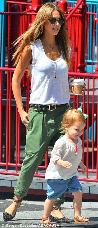 Matching: Jessica sported green trousers as her daughter wore a big green bow in her hair