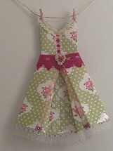 The 'Peggy-Sue' Can purchase on Etsy Handmade origami dresses - great gifts sold as individuals and in packages, come with rustic twine, miniature pegs for hanging and decoupaged self-adhesive pegs to mount 'clothesline' for display
