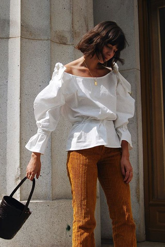 Play up the vintage feel of a pair of cords with a bucket bag and statement blouse. On Alyssa Coscarelli: Rejina Pyo Michelle Off-the-Shoulder Cotton-Blend Poplin Blouse ($450);...