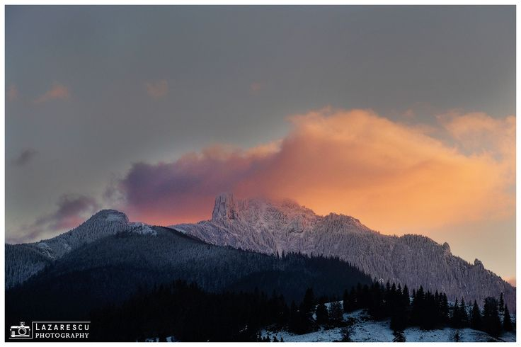 Winter sunset - Big cloud over the white mountain peak at sunset time.