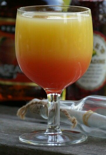 Tropical Paradise Mixed Drink 2 or 3 oz Rum, 2 oz Peach Schnapps, 3 oz Orange Juice, 3 oz Pineapple Juice, 2 teaspoons of Grenadine. Add ice to your hurricane or wine glass.Pour the rum, peach schnapps and juices. For a pretty presentation pour the grenadine in last. It falls to the bottom to leave a pretty red-orange color. Stir before drinking.