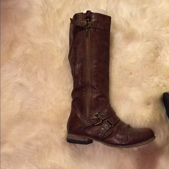 Brown Tall Carlos Santana Boots Super cute tall brown boots with nice zipper on buckles on each boot, great designer! Carlos Santana Shoes