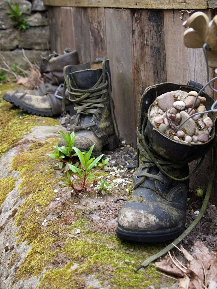 Getting creative in the garden - old boots as flower pots.