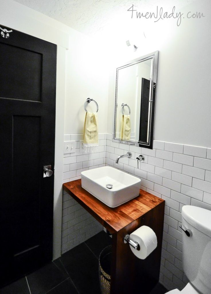 Bathroom vanity made from wood counter with waterfall edge and no cabinet. 4men1lady.com.