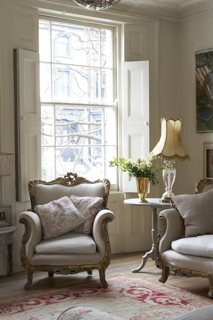 love the curve of the chair and sofa, the soft neutral tones and the inside shutters. (ditto)