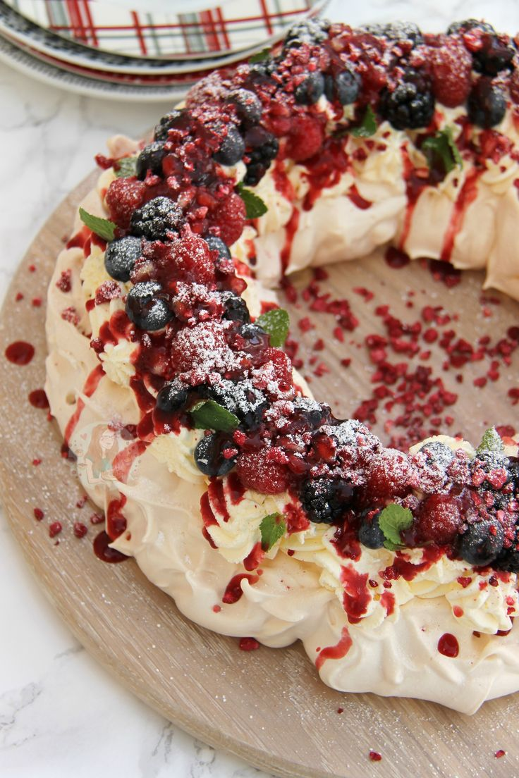 A Christmas Pavlova Wreath for the Festive Season; Your favourite Berries, Coulis, Mint, and delicious Whipped Cream! I was asked by the lovelies over at Wren's Kitchens to produce a recipe for them, but the theme was 'Christmas with a Twist'. I was immediately complete stuck for ideas as my immediate thought was my Christmas Pudding Chocolate Truffles, but they were already on my blog. I wanted to do something new and delicious! As I already wanted to post a new Pavlova recipe, but with a…