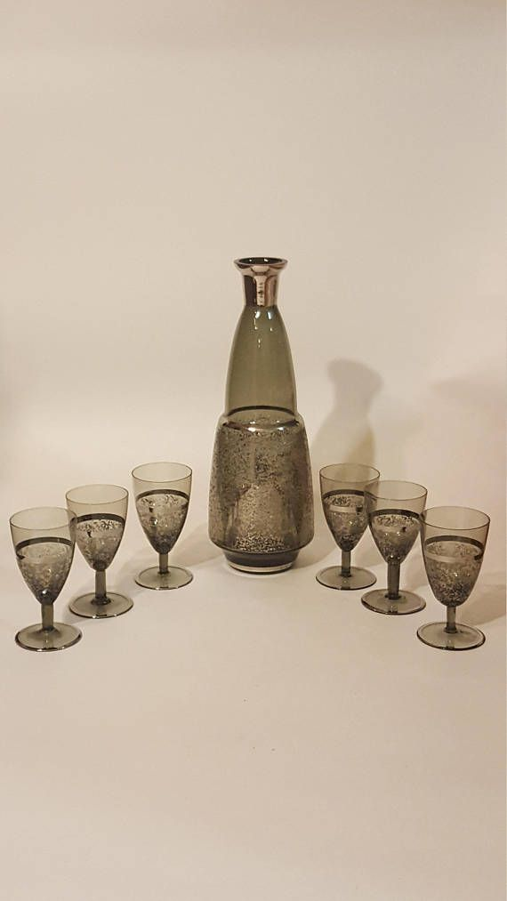 Check out this item in my Etsy shop https://www.etsy.com/ca/listing/580631675/vintage-speckled-decanter-and-glass-set