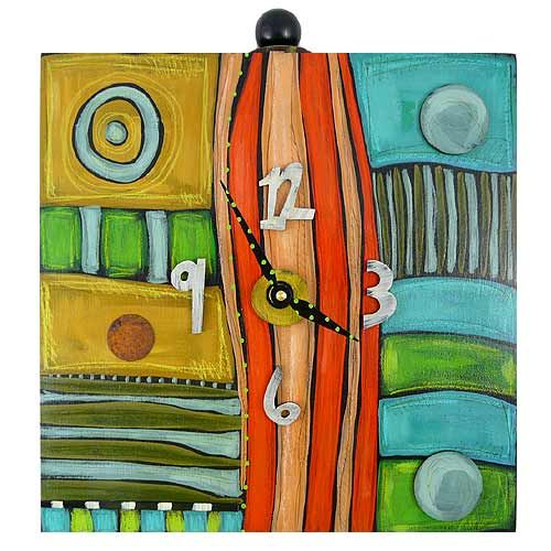 Eclectic Hand Painted Box Clock. An eclectic clock that appeals to the fun-loving side of your personality! Assembled from wood to form a box shape, the clock is hand-painted with diverse patterns in a wide range of rich, complementing colors. The thick box shape of the clock allows it to stand upright on a shelf or hang easily on the wall.
