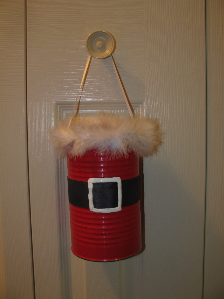 Santa tin! It was a pineapple juice tin can that I wrapped in red duct tape. Then I put thick black ribbon around the can, added white puffy paint for the belt buckle and fluffy stuff that I got at Michaels for the top.