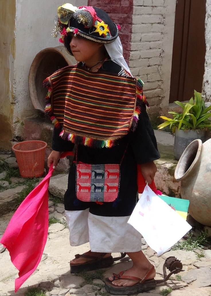 Little girl in Tarabuco Bolivia, waiting to dance, note the dancing shoes !