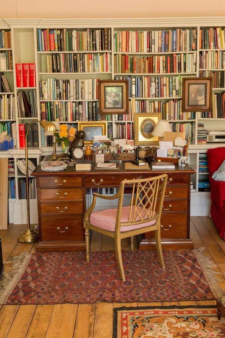 """The writing desk and bookshelves in the drawing room. The sale is to include some of the library, including a pre-publication copy of [i]Brideshead Revisited[/i] inscribed by Evelyn Waugh himself. LIKE THIS? THEN YOU'LL LOVE [link url=""""http://www.houseandgarden.co.uk/interiors/furnishings/rita-konig-decoration-advice""""]From paint to sofas, all Rita Konig's unmissable columns in one place »[/link]"""