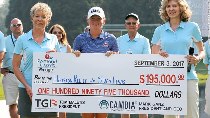Lewis poses with her winner's paycheck, donated to the Houston Relief Fund.