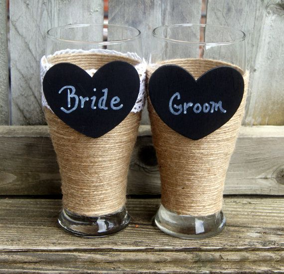 Bride and Groom Beer Glasses / Rustic by CarolesWeddingWhimsy, This is a set of 2 of Rustic Wedding Bride and Groom Beer Glasses, Country Wedding Toasting Glasses.  They are wrapped in jute, and have chalkboard hearts.  The bride's glass is trimmed in crochet lace.  This is a perfect engagement gift.  You can find it here https://www.etsy.com/listing/233108655/bride-and-groom-beer-glasses-rustic