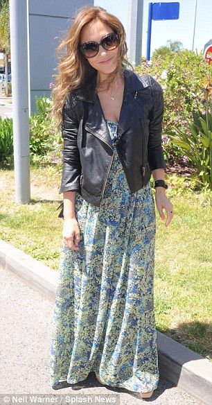 Klassy: Myleene sported a breezy floral print maxi-dress and cropped leather jacket for her flight to Nice