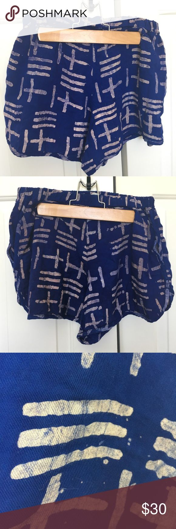 """Della Triton Track Shorts Vibrant indigo patterned shorts. Feature elastic waist and pockets. Ethically hand-dyed in Ghana.  Color: Indigo blue with graphic pattern  Size: Medium Condition: EUC, worn once Price: $30 Material: 100% rayon Measurements: Waist (flat across, unstretched): 13"""", length: 12.5"""". Della Shorts"""