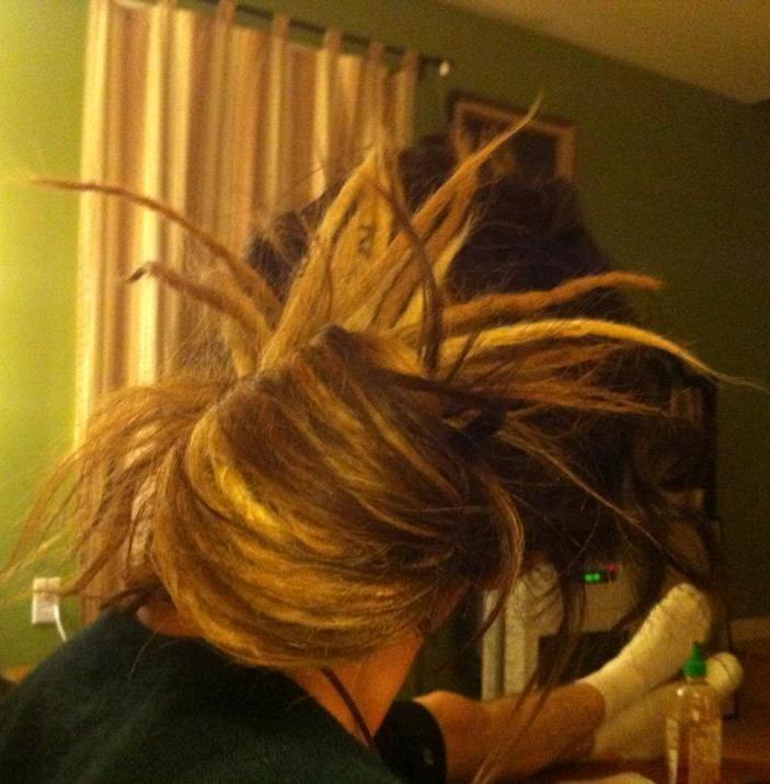 I'm SO dreading half of my hair!! So much cuter than full head of dreads!!