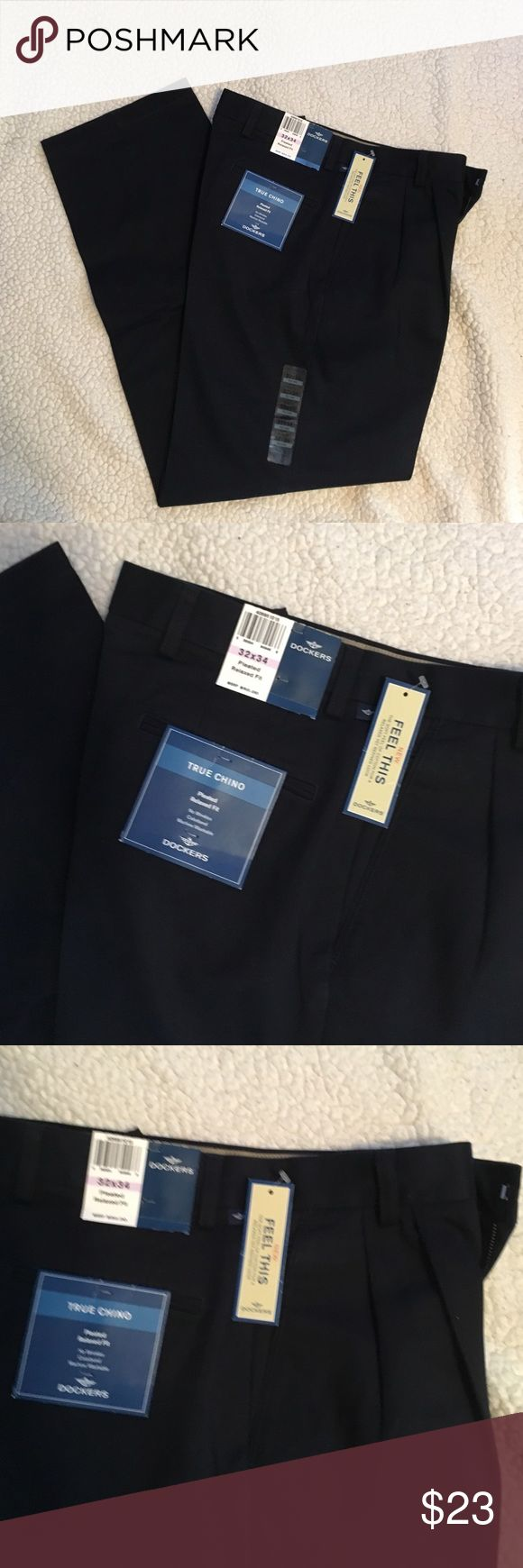 NWT Dockers Men's Chino Pleated Navy Pants 32x34 New Dockers Pleated relaxed fit navy blue dress pants size 32x34. These pants are 100% cotton, made in Bangladesh. Dockers Pants Dress