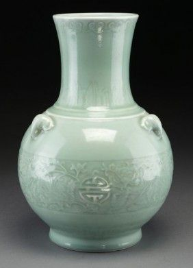 This Chinese celadon porcelain vase sold for $1700 at an April 11, 2011 sale by Dallas Auction Gallery. The vase features sheep's head handles, the body with incised decoration depicting bats, peonies and the character for longevity. It stands 14 1/4 inches high and dates to the early 20th century.