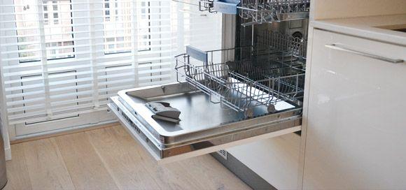 Handy! High placed dishwasher in design kitchen.