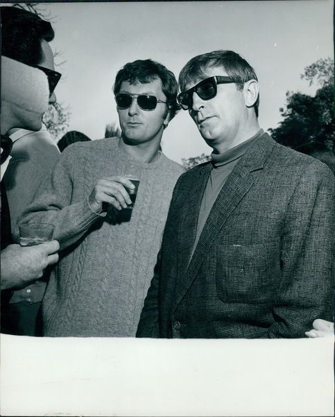 James  and  Robert  Mitchum. Father  and  son  in  1967  both  wearing  shades. This  is  a  gorgeous  pic  of  two  handsome  men  with  the  same  cleft  chin, and  similar  shades.