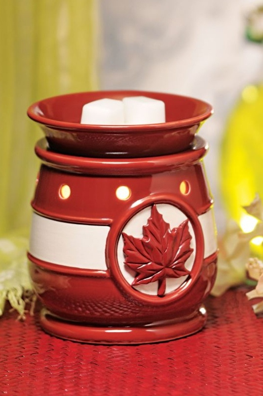"""""""O Canada"""" ~ Share your love of country with O Canada, a dramatic representation of the Canadian flag. This bold, heritage-red warmer features a debossed maple leaf on the base, accented by a stripe of white. And don't miss the matching peek-a-boo leaf in the dish! The perfect accent to your summer holiday decorations, display it proudly this Canada Day and whenever your heart swells with patriotic pride.  Premium-size warmer ~ $35. Purchase at www.bonniebuckhalt.scentsy.us"""