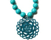 Crocheted necklace in teal blue by Loru