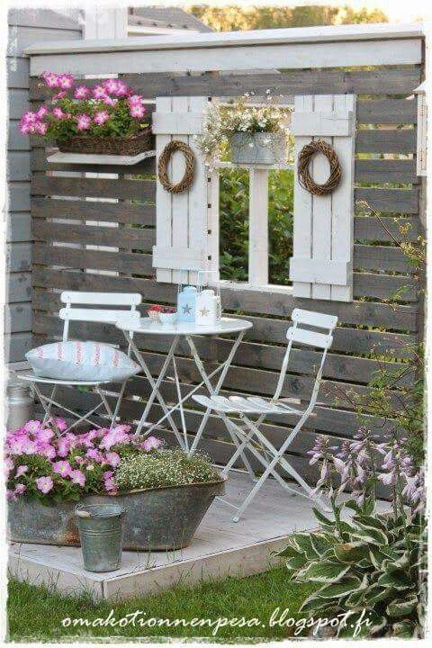 Create a sitting area outdoors with pallet wood and old shutters. From Junkyjoey / Facebook