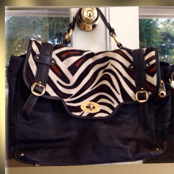 Pulicati Satchel Black Zebra Hair Calf Leather Womens Messenger- Crossbody- Large Handbag Brand: Pulicati- Made in Italy Fabric: Leather / Hair Calf Color: Black / Zebra Print Hair Calf Inside- 2 Slip Pockets- 1 Zipped Pocket 17 Wide X 11High X 5 Deep Small Handle 4.5 Condition: Pre-loved- Minor Scratch on Gold Tone Lock Beautiful pink satin interior has a mark see pictures Pulicati Bags Satchels