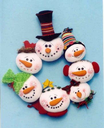 """Adorable 14"""" Snowman Wreath. Snowball heads are stuffed fleece circles mounted on a cardboard/metal ring frame."""