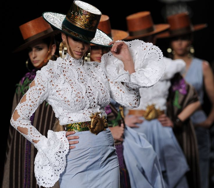 Models show part of the Aldebaran collection during the first day of the international flamenco fashion show in Sevilla. Photograph: Cristina Quicler/AFP/Getty Images