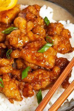Restaurant Style Asian Orange Chicken Recipe with Orange and Lemon Juice, Rice Vinegar, Soy Sauce, Orange Zest, Brown Sugar, Ginger Root, Garlic, Green Onion, and Boneless Skinless Chicken Breast