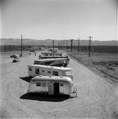 Vehicles line up to watch a nuclear bomb test in the Nevada desert: unpublished LIFE Magazine Photos From 1955