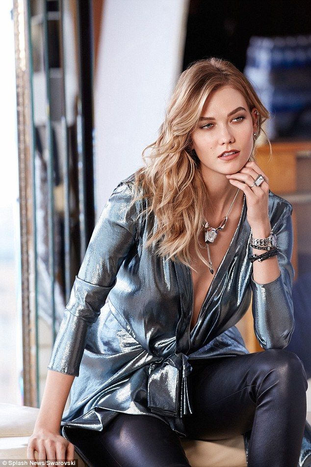 Hot stuff: The model stuns in a plunging metallic top and leather leggings...