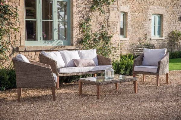 Ambersham Rattan Garden Sofa and Chairs. The stylish and contemporary design makes the Ambersham Rattan Outdoor Furniture Set perfect for indoor use in both garden rooms and conservatories.  The beautiful white cushions are easy to maintain, with their shower proof fabric.