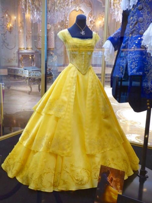 Emma Watson's golden gown Belle costume from Beauty and the Beast, designed by Jacqueline Durran, on display.