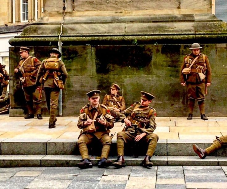 This picture, taken by Chris Alexander, captures some of the acting soldiers sitting on st...