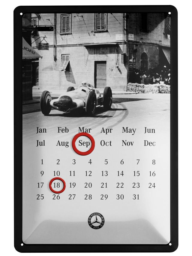 Part number:     B66041492  Metal calendar. Black/white. Metal. Convex. Black and white 1938 W154 Silver Arrow motif.  Embossed race car. 2 circular red magnets for marking date. Classic logo print.