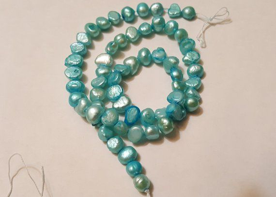 Cultured Pearls Dyed Teal Blue 5 6mm Flat Sided Potato D Grade 14 Inches Cultured Pearls Teal Blue Beautiful Beads