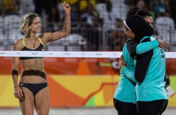 Nada Meawad (C) and Doaa Elgobashy (R) of Egypt hug as Laura Ludwig of Germany gestures during the women's Beach Volleyball preliminary pool D game between Ludwig/Walkenhors of Germany and Elghobashy/Nada of Egypt the Rio 2016 Olympic Games at the Beach Volleyball Arena on Copacabana Beach in Rio de Janeiro, Brazil, 07 August 2016.