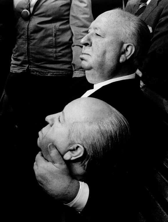 Alfred Hitchcock on the set of Frenzy (1972) holding a mold of his own head
